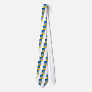 Canola field in summer with yellow flowers and blu neck tie