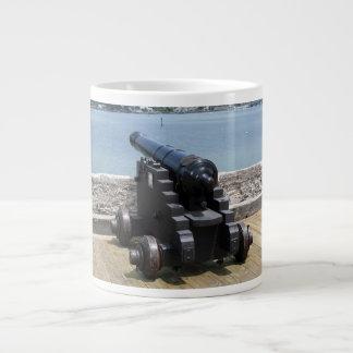 Canon over castle wall large coffee mug