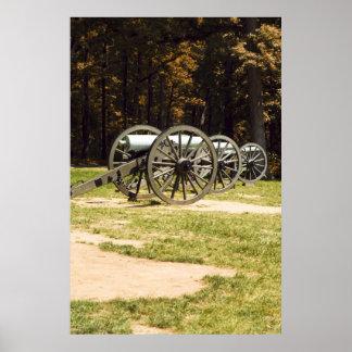 Cañones del campo de batalla en el poster del PA d