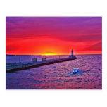 Canotaje en la salida del sol tarjeta postal