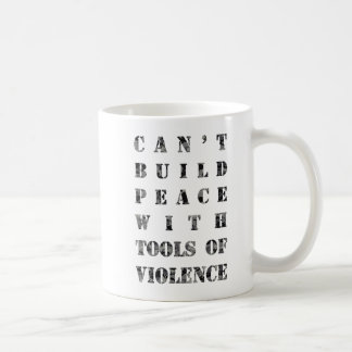 Can't build peace with tools of violence (darker) coffee mug