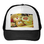 Cantaloupes and melons on cutting board with flowe trucker hats