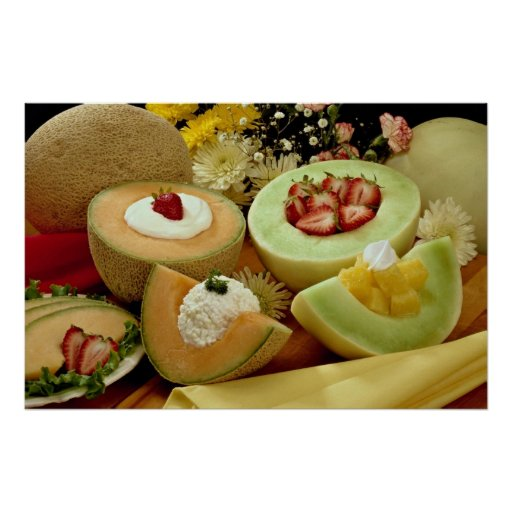 Cantaloupes and melons on cutting board with flowe print