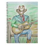 Cantante del vaquero cuaderno