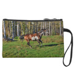 Cantering Paint Stallion & Forest Equine Photo Wristlet Clutches