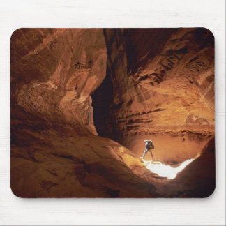 Canyoneer illuminated in the depths of a narrow mouse pad