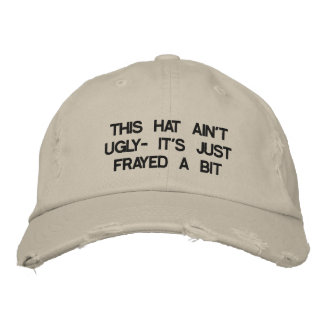 Cap with saying on it.