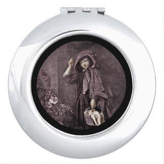 Capa con capucha en el Doorstop de las abuelas Espejo De Maquillaje