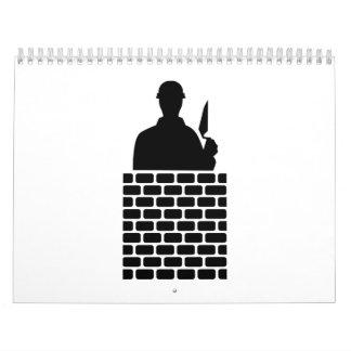 Capa de ladrillo del albañil calendario de pared