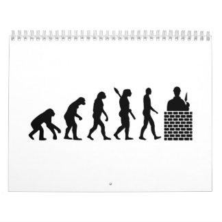 Capa de ladrillo del albañil de la evolución calendarios de pared