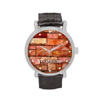 Capa rojiza de la pared de piedra con su nombre relojes de pulsera