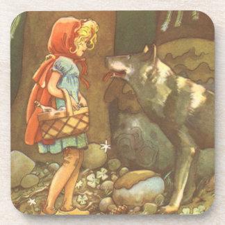 Caperucita Rojo y lobo del vintage en bosque Posavaso