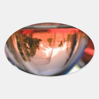 Capilla del soporte en una copa de vino pegatina ovalada