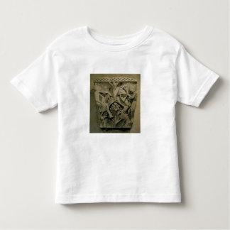 Capital depicting a man shooting an arrow into the tee shirt