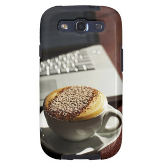 Cappuccino in front of laptop galaxy SIII cover