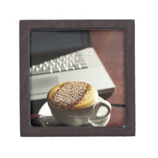 Cappuccino in front of laptop gift box