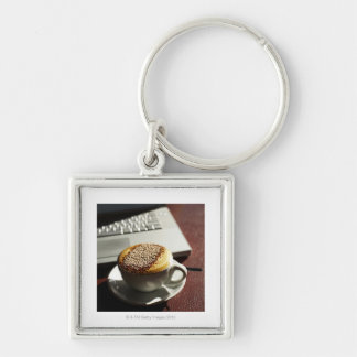 Cappuccino in front of laptop Silver-Colored square keychain