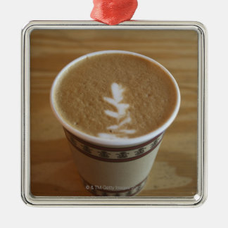 Cappuccino with tree design in foam metal ornament