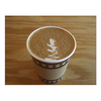 Cappuccino with tree design in foam postcard