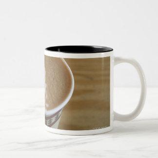 Cappuccino with tree design in foam Two-Tone coffee mug