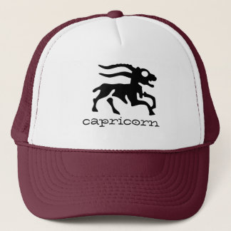 Capricorn in black trucker hat