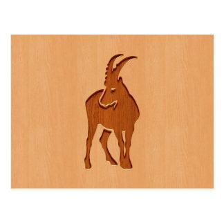 Capricorn silhouette engraved on wood design postcard