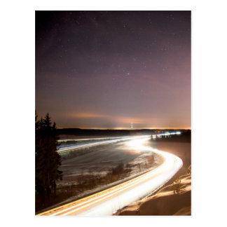 Car and train light streaks postcard