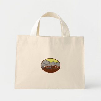 Car being towed Away Mountains Oval Woodcut Mini Tote Bag