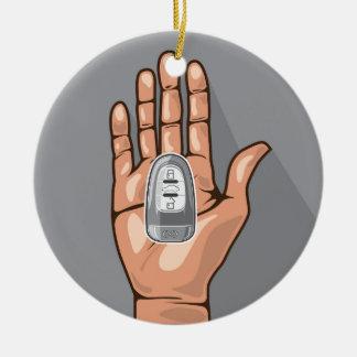 Car key in a hand vector ceramic ornament