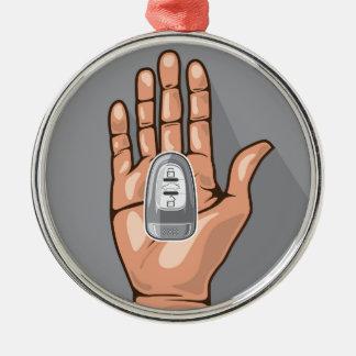 Car key in a hand vector metal ornament