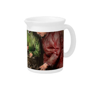 Car Mechanic - In a mothers care 1900 Beverage Pitcher