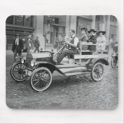 Domestic Auto Racing on Of A Man Giving Some Women A Ride In A Open Air Auto During A Car