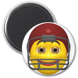 Cara amarilla del smiley del fútbol imán