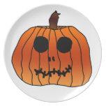 Cara anaranjada del esqueleto de la calabaza de plato de cena