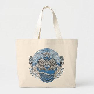 Cara azul del mono con el modelo y las plumas bolsa tela grande