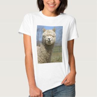 Cara blanca borrosa de la alpaca poleras