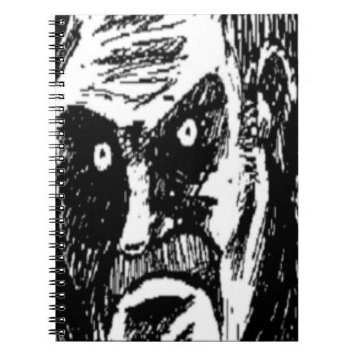Cara cómica de la mirada fija enojada libros de apuntes con espiral