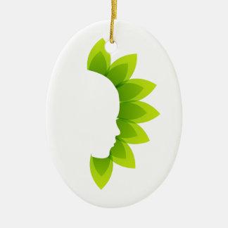 Cara con las hojas verdes adorno ovalado de cerámica