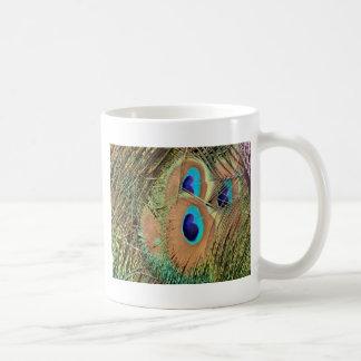 Cara de la pluma del pavo real taza de café