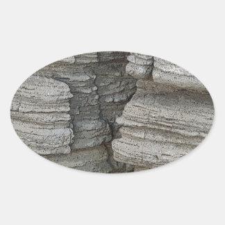Cara de la roca pegatina ovalada