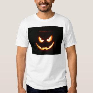 Cara de mueca malvada de la calabaza de Halloween Playeras