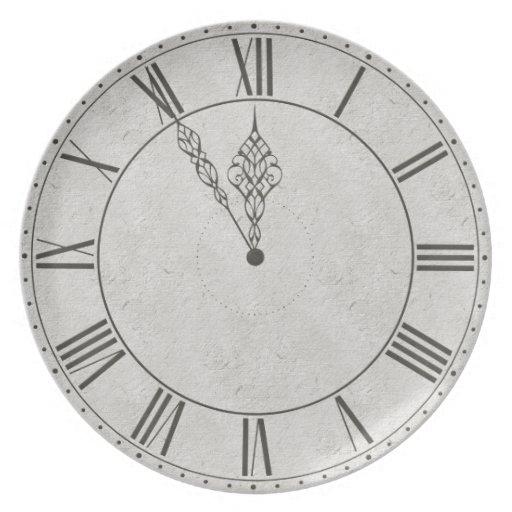 Cara de reloj negra y blanca del número romano plato de comida