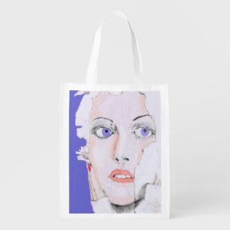 Cara de un chica con los ojos azules bolsas reutilizables