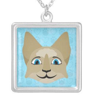 Cara del gato del animado con los ojos azules pendientes
