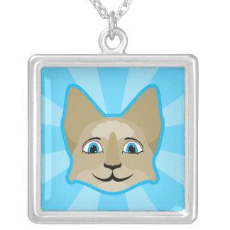 Cara del gato del animado con los ojos azules pendiente
