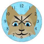 Cara del gato del animado con los ojos azules reloj de pared