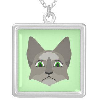 Cara del gato del animado con los ojos verdes joyerias personalizadas