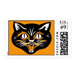Cara del gato negro de Halloween del vintage Franqueo
