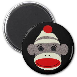 Cara del mono del calcetín imán redondo 5 cm
