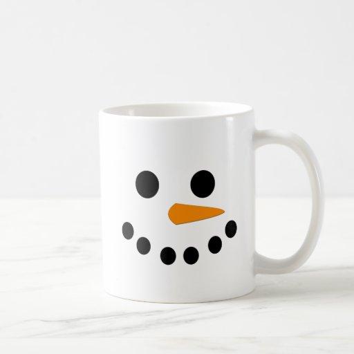 Cara del muñeco de nieve tazas de café